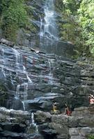 Water cascading down rocks at Kavak, an Indian village near Angel Falls in Venezuela, South America 20025347357| 写真素材・ストックフォト・画像・イラスト素材|アマナイメージズ