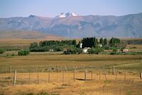 Ranch at Villa Castillo, farmland and mountains behind, in Patagonia, Chile, South America