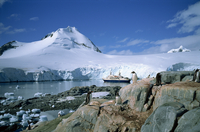 The cruise ship World Discoverer at anchor in Port Lockroy, once a Second World War British Station, now a post office, Antarcti