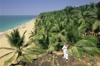 Beach and coconut palms, Kovalam, Kerala state, India, Asia