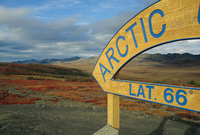 Arctic Circle crossing point on road across tundra, Dempster Highway, Yukon, Canada