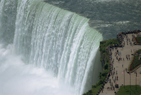 Tourists on viewing platform on Canadian side of the waterfall view the Horseshoe Falls at Niagara, Ontario, Canada, North Ameri