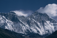 Mount Everest, peak on the left with snow plume, seen over Nuptse ridge, Himalayas, Nepal, Asia