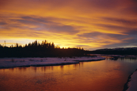 Sunset over a warm river in winter, Yellowstone National Park, Wyoming, United States of America