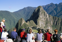 Tourists looking out over Machu Picchu, UNESCO World Heritage Site, Peru, South America