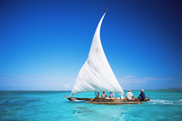 Outrigger canoe with sail on Indian Ocean, off Jambiani, Zanzibar, Tanzania, East Africa, Africa