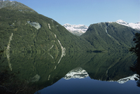Reflection of mountains in the water of Lake Gunn in the Fjordland National Park, UNESCO World Heritage Site, Southland, New Zea
