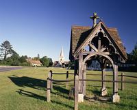 Pump, village green and church in the distance, Brockham, near Dorking, Surrey, England, United Kingdom, Europe