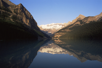 View to Mount Victoria across the still waters of Lake Louise, at sunrise in summer, Banff National Park, UNESCO World Heritage