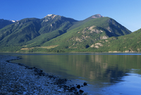 The rocky western shore of Kootenay Lake in the evening, near Kaslo, British Columbia (B.C.), Canada, North America