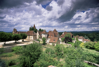 The village amidst the verdant surroundings of the Dordogne valley, Carennac, Lot, Midi-Pyrenees, France, Europe