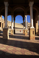 View through arches to the Palacio Espanol, Plaza de Espana, Parque de Maria Luisa, Seville, Andalucia (Andalusia), Spain, Europ