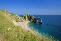 View from coastal path of Durdle Door, arch of Purbeck limestone, near West Lulworth, Dorset, England, UK