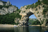 The Pont d'Arc, a natural rock arch over the Ardeche River, in the Ardeche Gorges, in the Ardeche region of the Rhone Alpes, Fra