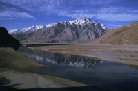 Indus River at Skardu looking downstream, Mount Marshakala, 5150m, Mashabrum Range, Karakorams, Baltistan, Pakistan, Asia