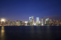 Full moon rising over Lower Manhattan skyline across the Hudson River, New York City, New York, United States of America, North