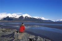 Woman looking at glaciers along the Seward Highway, Girdwood, Alaska, United States of America, North America