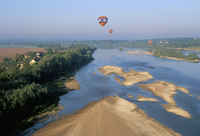 Hot air ballooning above the Loire River, Blois region, Pays de Loire, France, Europe