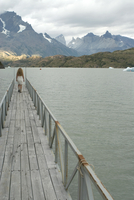 Blonde woman walks to the end of dock on Lago Grey, Torres del Paine, Chile, South America 20025350810| 写真素材・ストックフォト・画像・イラスト素材|アマナイメージズ
