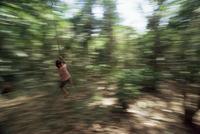 Local boy swings on vine, Corcovado National Park, Peninsula de Osa, Costa Rica, Central America