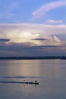 Small fishing boat moving down giant river, Amazon River, Peru, South America 20025350862| 写真素材・ストックフォト・画像・イラスト素材|アマナイメージズ