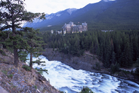 Banff, the Bow Falls and prestigious Banff Springs Hotel, at dusk, Banff National Park, UNESCO World Heritage Site, Alberta, Can