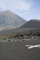 White cross is a marker to check for land movement within the caldera, with the Pico de Fogo volcano in the background, Fogo (Fi