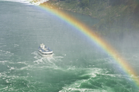 Maid of the Mist tour excursion boat under the Horseshoe Falls waterfall with rainbow at Niagara Falls, Ontario, Canada, North A