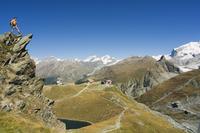 Hiker on trail above lake at Schwarzee Paradise, Zermatt Alpine Resort, The Valais, Swiss Alps, Switzerland, Europe