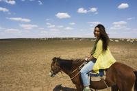 Chinese girl horseriding, Xilamuren grasslands, Inner Mongolia province, China, Asia