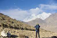 Trekker taking a photo on the Annapurna circuit trek, between Jomsom and Muktinath, Himalayas, Nepal, Asia