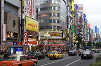 Neon signs light up the Kabukicho entertainment district in Shinjuku, Tokyo, Japan, Asia