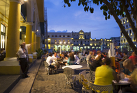 Eating al fresco in the evening, Plaza Vieja, Old Havana, Cuba, West Indies, Central America