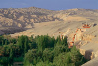 The Mogao Grottoes at the desert of Dunhuang. Located on the