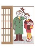 玄関先で挨拶をする若夫婦