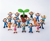 ビジネスマンと芽吹いた双葉 20037000162| 写真素材・ストックフォト・画像・イラスト素材|アマナイメージズ