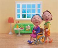 車椅子の老女を介護する女性