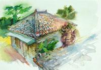 沖縄の瓦屋根の家とシーサー