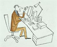 デスクで仕事をする男性