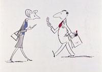 携帯電話を操作しながら歩く男女