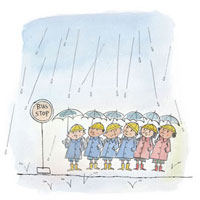 雨の中バス停にいる小学生