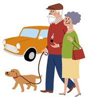 犬を散歩するシニアカップル