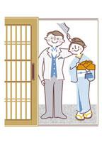 玄関で挨拶をするカップル