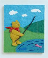 魚を釣る熊