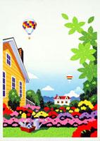 花があふれる庭と気球