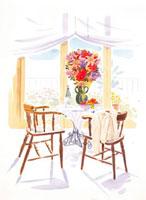 窓際のテーブルの上に乗った花
