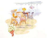 椅子と花の乗ったテーブル