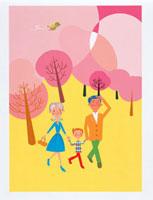 桜の中を歩く家族