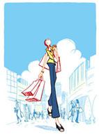 ショッピングバックを持って歩く女性