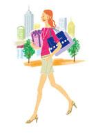 ショッピングバッグを持って歩く女性